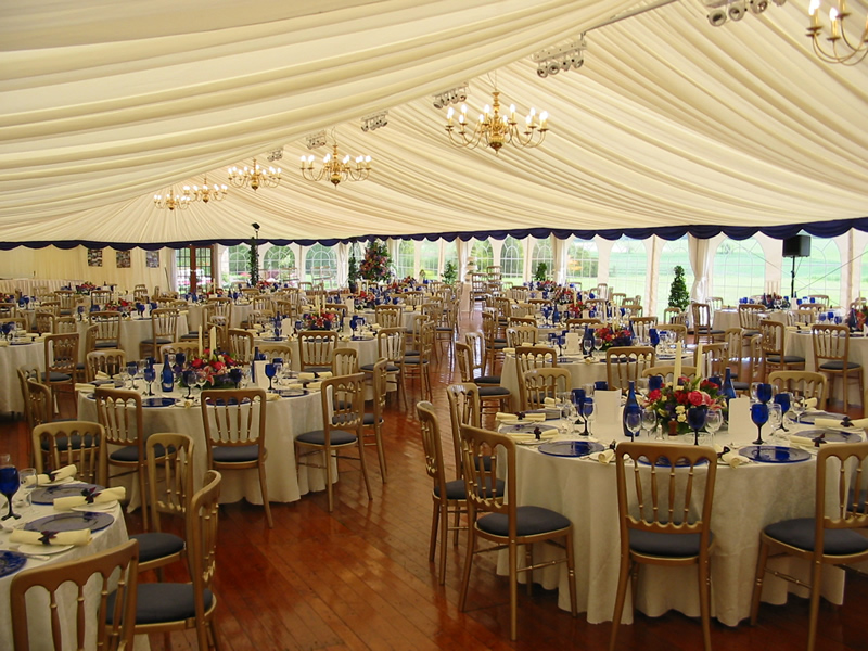 Allison Stiven - Wedding Marquee showing tables, chairs and place-settings